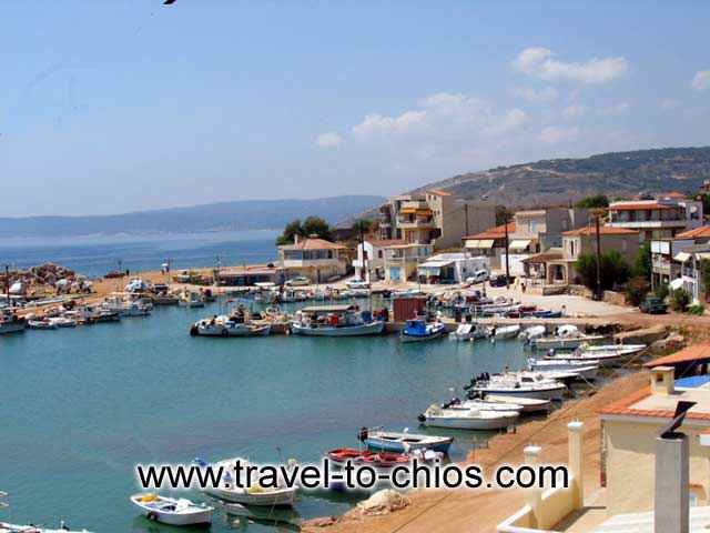 AGIA ERMIONI - View of the small fishing boats port and the beach at Agia Ermioni in Chios island Greece