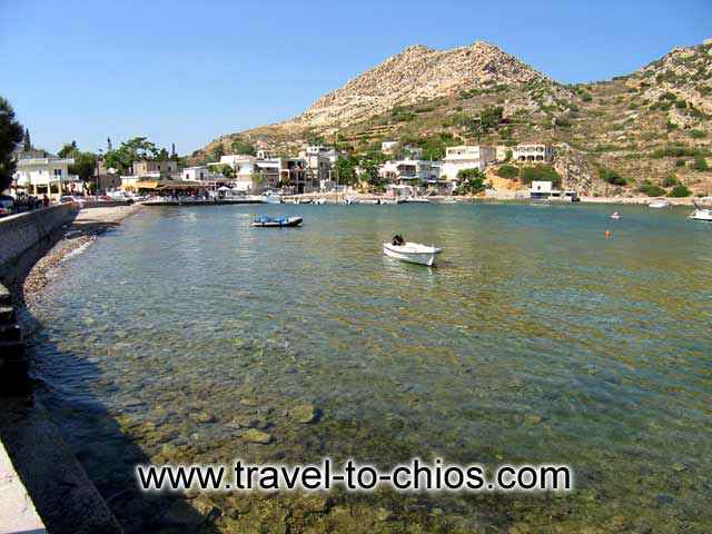 EMPORIOS - View of the small beach of Emporios and some fishing boats